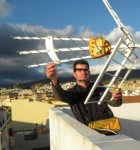 A viewer in Malaga adjusts his antenna.