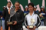 Pennetta and Suarez, each receiving the trophy she deserves.