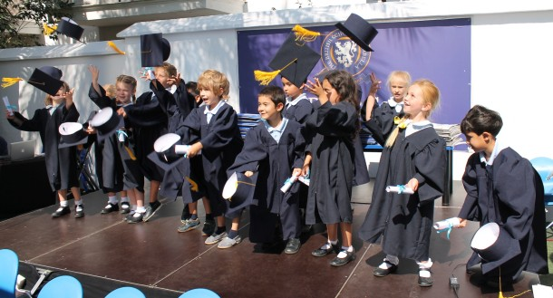 Children from Reception throwing their mortar boards into the air