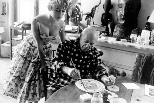 Actress Brigitte Bardot watching Pablo Picasso at work in his studio in Vallauris during the 1956 International Cannes Film Festival. (Photo by Jerome Brierre/RDA/Getty Images)
